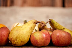Apples and üears on a table as rustical background Stock Photo