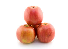 Apples. Put in pyramid on white background Royalty Free Stock Photo