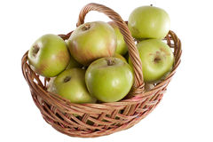Apples. Brown basket full of red and green apples Royalty Free Stock Images
