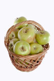 Apples. Brown basket full of red and green apples Royalty Free Stock Photography