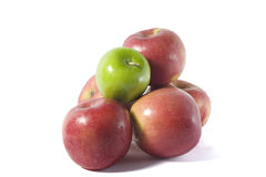 Apples. Five red apples and one green apple depicts the uniqueness of the green, be it superior or inferior Royalty Free Stock Photo