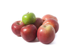 Apples. Six red apples and a green apple isolated on white background Royalty Free Stock Photography
