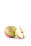 Apples. Apple and half isolated on white background Royalty Free Stock Photos