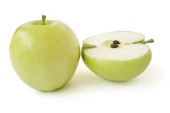 Apples. A single whole and it the cut apple isolated on a white background Royalty Free Stock Images