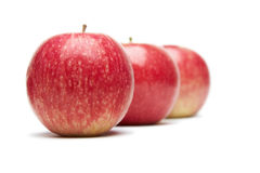 Apples. Three red apples on a white background royalty free stock photo