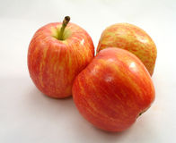 Apples. Three red, ripe apples on white background royalty free stock photography