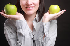 Apples. Smiling woman with green apples in hands Royalty Free Stock Image