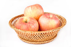 Apples. Three apples in the basket Royalty Free Stock Photography