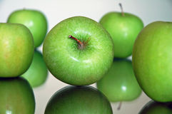Apples. Green apples on reflexive glass base Stock Photography