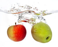 Apples. Two apples splashes into water Stock Photo