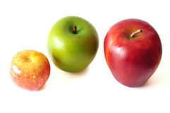 Apples. A photo taken on 3 apples of different sizes and color against a white backdrop Stock Photo