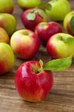 Apples. Red and green apples on a wooden background Royalty Free Stock Images