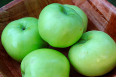 Apples. In a wooden bowl Stock Images