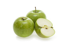 Apples. Three tasty green apples isolated on white background Stock Photos