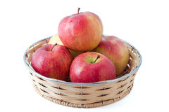 Apples. In basket isolated in white with small shadow Stock Images