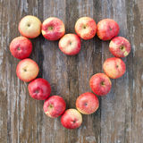Apples. Heart with apples on wooden background Stock Image