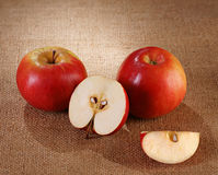 Apples. Red apples and lapple slices  on a brown background Stock Images