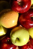 Apples. A pile of fresh picked red and yellow apples with drops of water on them Stock Photo