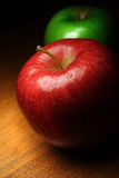 Apples. Red and green apples on wooden surface Stock Images