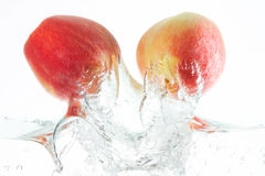 Apples. Two apples jumping out of the water Stock Photos