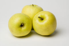 Apples. Three yellow apples on a white background royalty free stock images