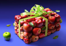 Apples. A parallelepiped from red apples as a gift is on a dark blue background Royalty Free Stock Photo