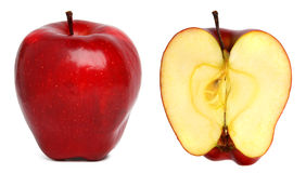 Apples. Red ripe apple and half of another red apple royalty free stock image