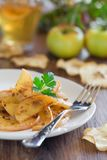 Apples with anchovies Stock Photo