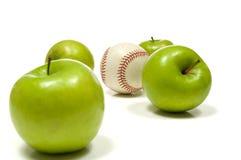 Apples And A Baseball Royalty Free Stock Photos
