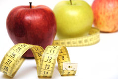 Apples And Measuring Tape Isolated Royalty Free Stock Images