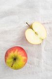 Apples. Apple and apple half on a linen tablecloth Royalty Free Stock Images