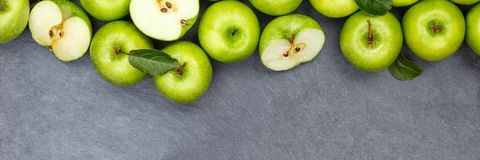 Apples apple fruit fruits banner copyspace slate green top view Stock Photo