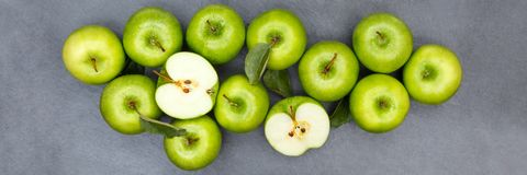 Apples apple fruit fruits banner slate green top view Stock Image