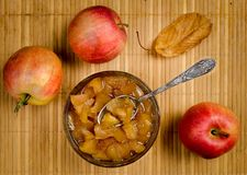 Apples and apple jam in a vase with a spoon. Top view Stock Photography