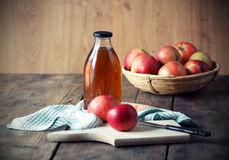 Apples and Apple Juice. Apples and Apple Juice, on wooden table Royalty Free Stock Images