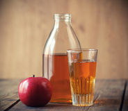 Apples and Apple Juice. Apples and Apple Juice, on wooden table Royalty Free Stock Photography