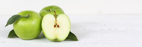 Apples apple slice fruit fruits green banner copyspace on wooden Royalty Free Stock Images