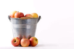 Apples around and in Bucket Stock Photography