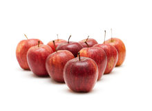 Apples arranged as triangle. On white background royalty free stock photo