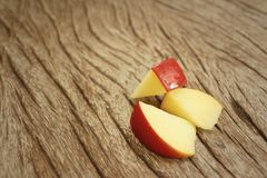 Apples on a background of brown wood. Stock Photos