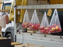 Apples in hanging bags. Apples in bags hanging on a wooden beam Stock Photo