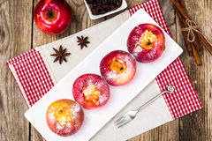 Apples, baked in the oven with honey and raisins Royalty Free Stock Photos