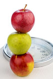 Apples on a balance Royalty Free Stock Images