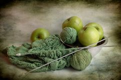 Apples and balls of threads Royalty Free Stock Photo