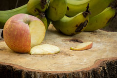 Apples, bananas, green, knife, texture, wood floors. Royalty Free Stock Photo