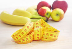 Apples and bananas with tape measure - diet concept Stock Image
