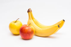 Apples and bananas Stock Photos