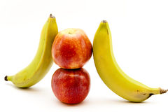 Apples and bananas. On white background Royalty Free Stock Image