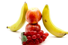 Apples and bananas. On white background Royalty Free Stock Photography