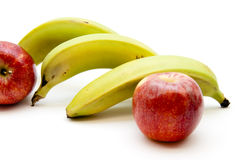 Apples and bananas. On white background Stock Image